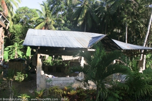 This was the first damaged home I photographed on my first commute to work in Bohol.